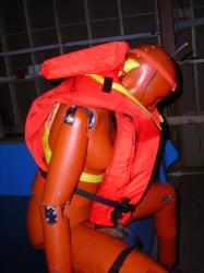 Female Flotation Dummy on Water Tank and in it.